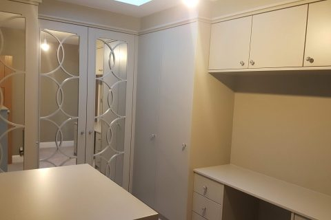 Dressing room with mirrored fretwork wardrobes